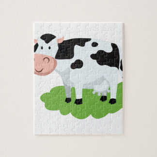 Puzzle vaca de ordeño en el jardín