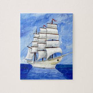 Puzzle velero blanco en el mar azul
