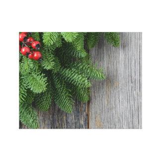 Rama de árbol de navidad con la baya del acebo lienzo