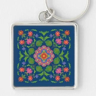 Llavero Rangoli floral elegante en llavero cuadrado azul