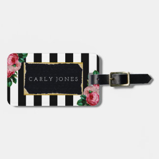 Rayas negras y etiqueta floral del equipaje