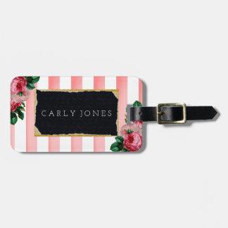 Rayas rosadas y etiqueta floral del equipaje
