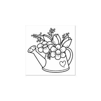 Regadera del jardín con las flores sello de caucho