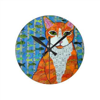Reloj anaranjado del gato de Tabby