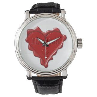 Reloj Brezo. Sello rojo de la cera del corazón con el