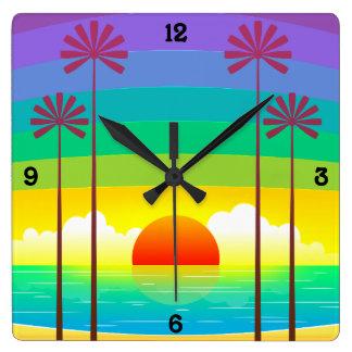 Reloj Cuadrado Puesta del sol colorida en la playa con las