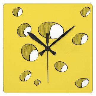 Reloj Cuadrado Queso con los agujeros