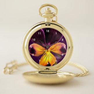 Reloj de bolsillo púrpura y amarillo del extracto
