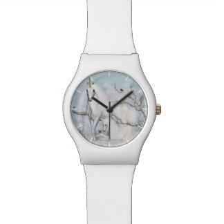 Reloj de los petirrojos y de los unicornios