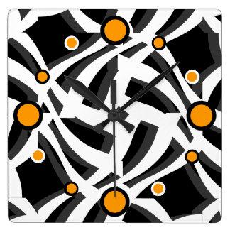 Reloj de pared anaranjado abstracto blanco negro