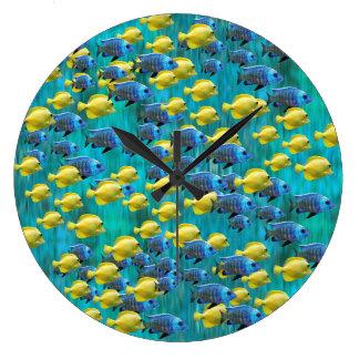 Reloj de pared azul y amarillo redondo de los