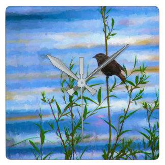 Reloj de pared de las reflexiones del pájaro