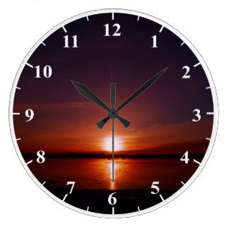 Reloj de pared grande redondo de la salida del sol