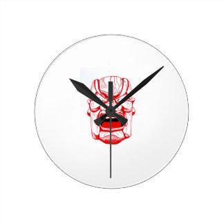 Reloj de pared rojo de la máscara