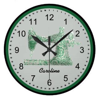 Reloj de pared verde de la máquina de coser del