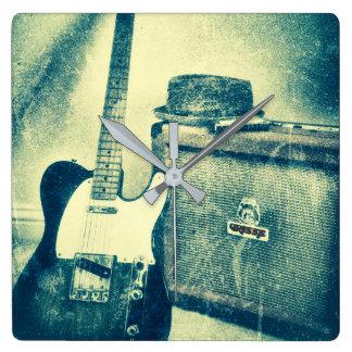 reloj del bluesman de la armónica del amperio de