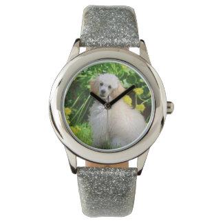 Reloj del perro de caniche de juguete
