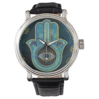 Reloj Mano decorativa de Hamsa con el fondo de Paisley