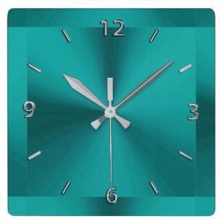 Reloj metálico del verde oscuro del trullo