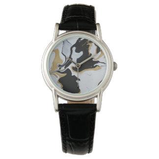 reloj negro del mármol del oro