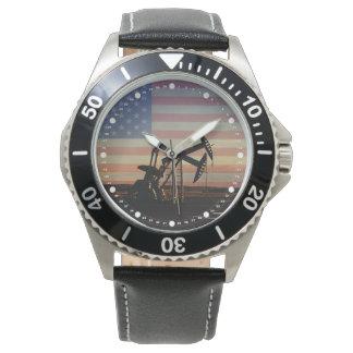 Reloj Pozo de petróleo y bandera americana