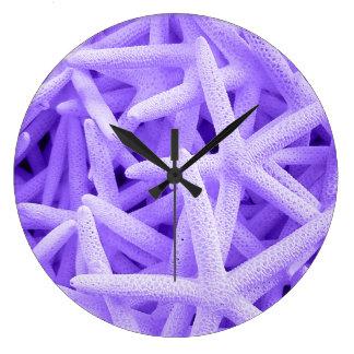 Reloj redondo de la casa de playa de las estrellas