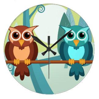 Reloj redondo de los búhos del bosque