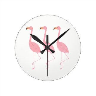 Reloj redondo de tres flamencos