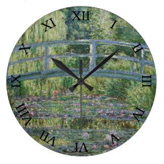 Reloj Redondo Grande Lirios japoneses del puente y de agua de Claude