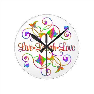 Reloj Redondo Mediano Flourish vivo del amor de la risa