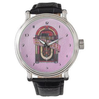 Reloj retro rosado de la máquina tocadiscos de la