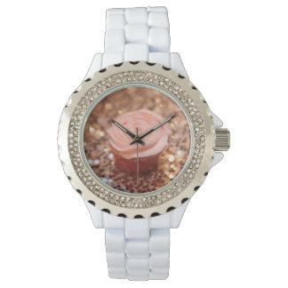 Reloj rosado de la magdalena