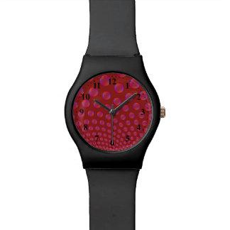 Reloj violeta y rojo de las burbujas