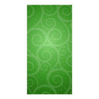 Remolinos verdes del fondo tarjeta