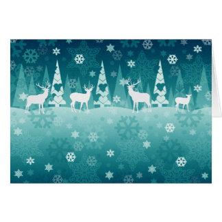 Reno en tarjeta de Navidad de la nieve