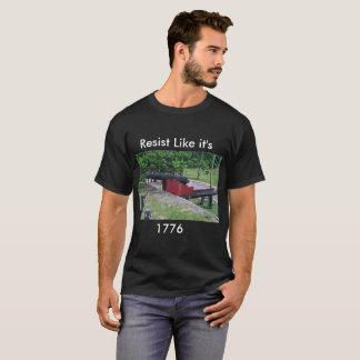 Resista la camiseta con el cañón colonial