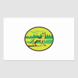 Retro oval del paisaje de la montaña del coyote pegatina rectangular