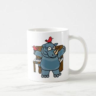 Rinoceronte del CU que juega la taza del piano