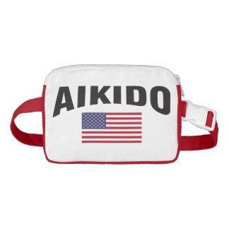 Riñonera El Aikido Estados Unidos señala por medio de una
