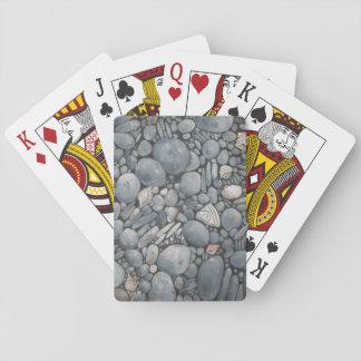 Rocas de la playa y guijarros de las piedras barajas de cartas