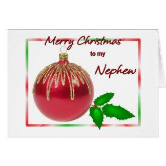 Rojo del sobrino de las Felices Navidad y bola del Tarjeta De Felicitación