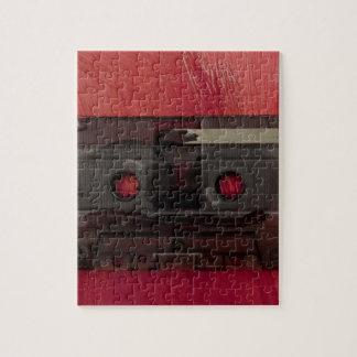 Rojo del vintage de la música de la cinta de puzzle