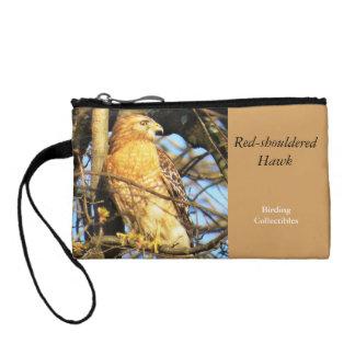 Rojo-llevó a hombros la bolsa del halcón