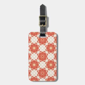Rojo y modelo floral del cordón del oro etiqueta de equipaje