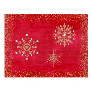 Rojo y oro de los copos de nieve del navidad postal