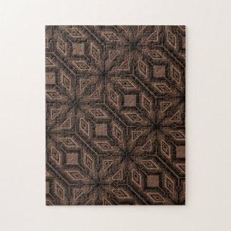 Rompecabezas marrón del mosaico con la caja de