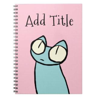 Rosa de los gatos el mirar fijamente del azul cuaderno