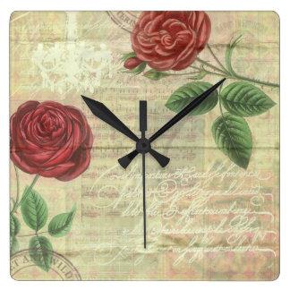 Rosas del vintage y reloj de pared de la música
