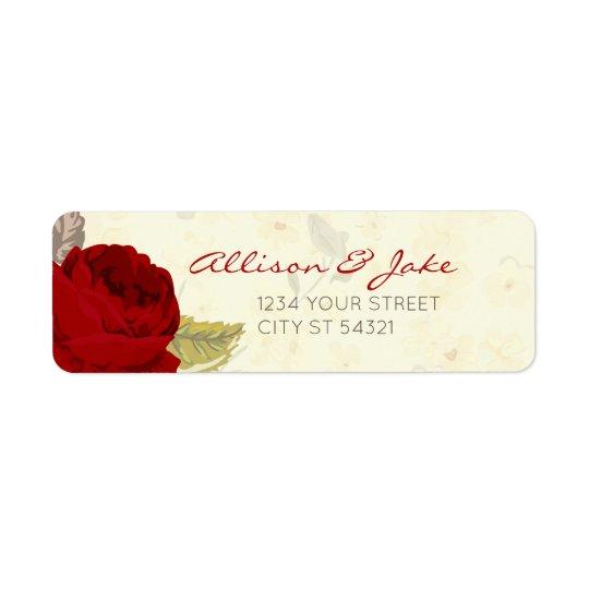 Rosas rojos y de marfil que casan etiquetas de