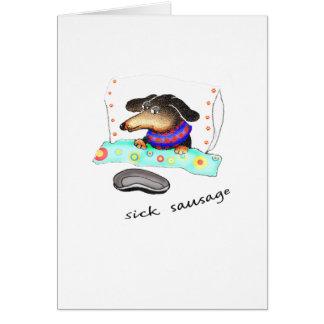 Salchicha enferma, enfermedad en cama, humor del tarjeta de felicitación